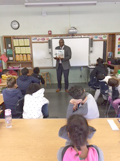 Photo of Dr. Tutwiler Reading To Students